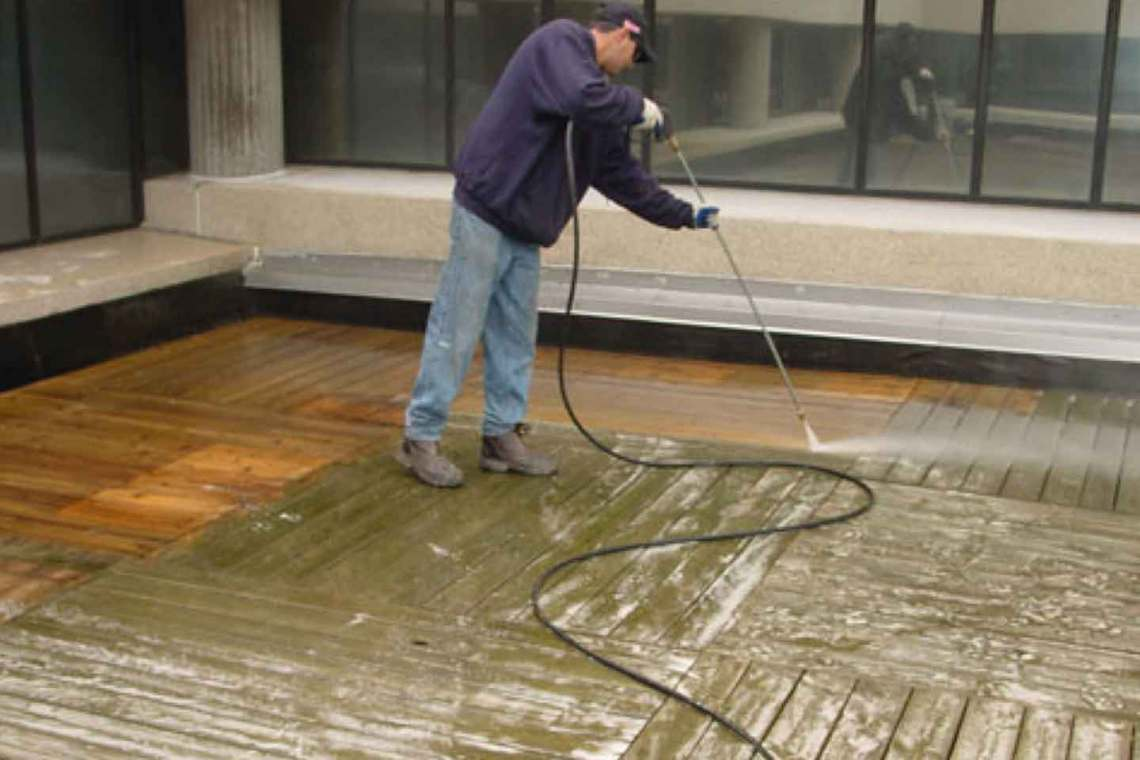 Power Washing Wood Rooftop Deck