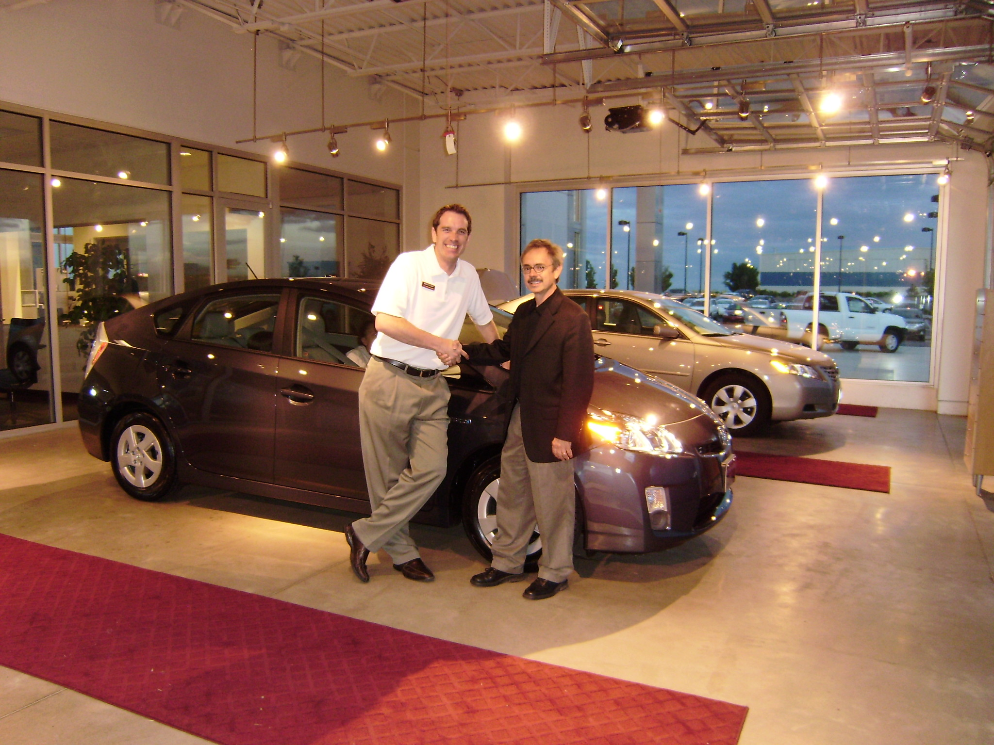 Alan Ford posgin with Brion Stapp and his new 2010 Prius!