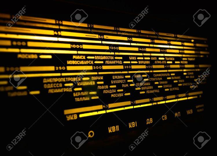 13510918-Radio-scale-on-black-background-old-radio-close-up-Stock-Photo