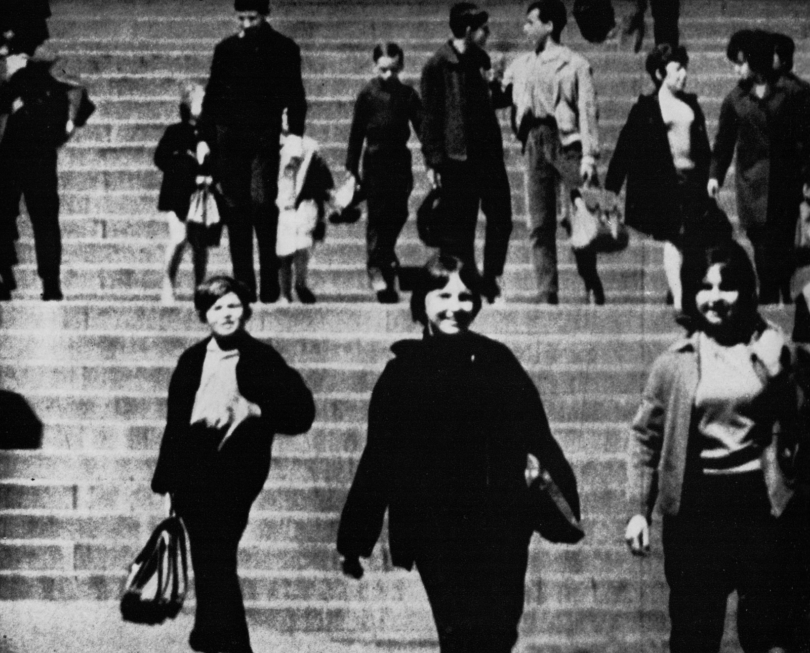 Young people walk down steps