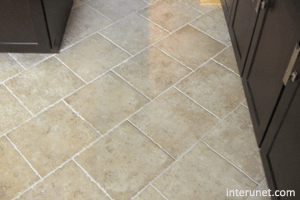 kitchen floor covering recycling bins best flooring for a interunet ceramic tile