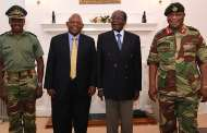 Captor and Captive: Striking Picture of Zimbabwean Coup Leader and Mugabe