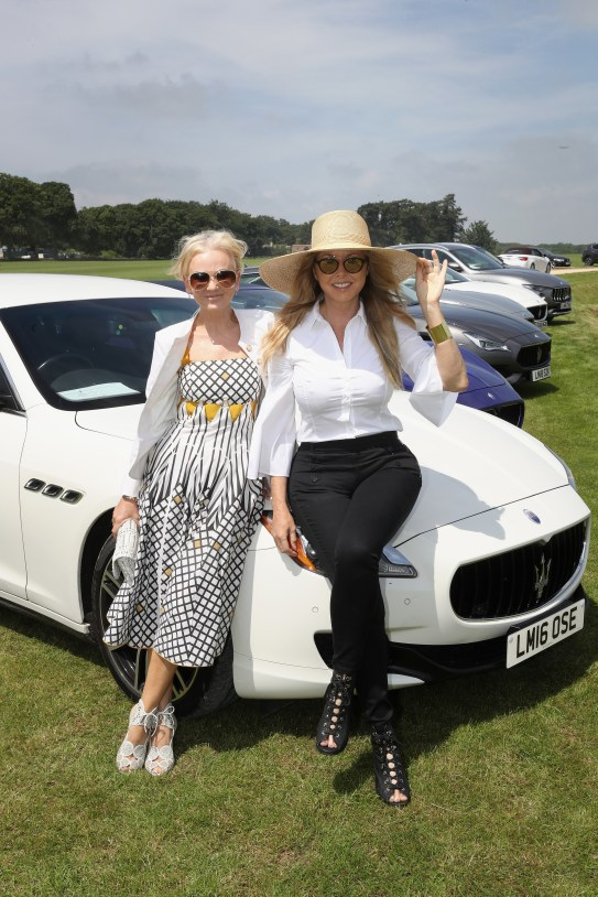 TETBURY, ENGLAND - JUNE 10: Maserati Royal Charity Polo Trophy 2018 – Lisa Maxwell (L) and Carol Vorderman with the Maserati Quattroporte attend the Maserati Royal Charity Polo Trophy 2018 at Beaufort Polo Club on June 10, 2018 in Tetbury, England. (Photo by Chris Jackson/Getty Images for Maserati / La Martina) *** Local Caption *** Carol Vorderman; Lisa Maxwell