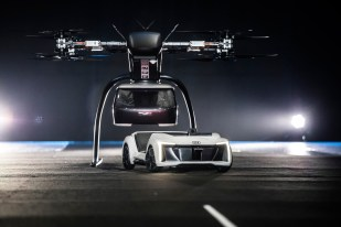 "At Drone Week in Amsterdam Audi, Airbus and Italdesign are presenting for the first time a flying and driving prototype of ""Pop.Up Next"". This innovative concept for a flying taxi combines a self-driving electric car with a passenger drone. In the first public test flight, the flight module accurately placed a passenger capsule on the ground module, which then drove from the test grounds autonomously. This is still a 1:4 scale model."