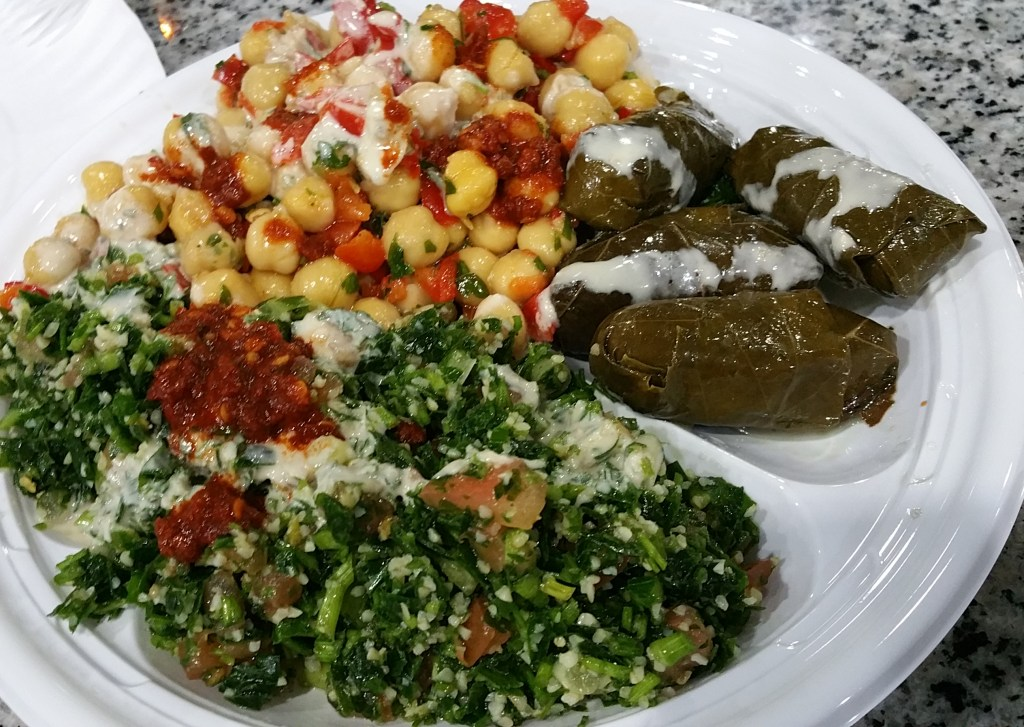 Plate of tabouli, chickpeas and grape leaves from Oasis in Brooklyn.
