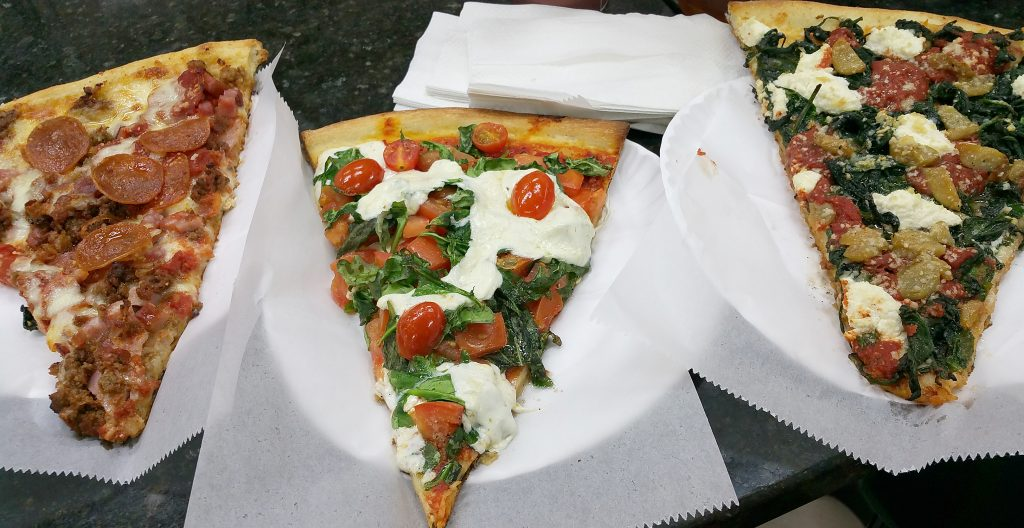 Three large pizza slices from Anna Maria Pizza and Pasta in Brooklyn