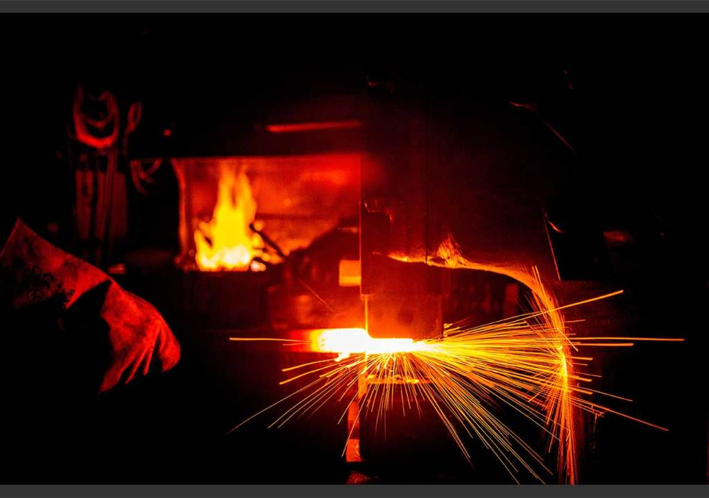 Will O'Brien working in his forge