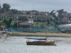 Pretty little clinker yacht outside Medway cruising club's premises