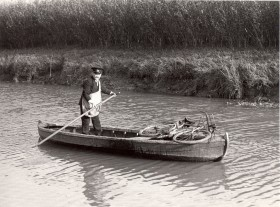 Postman using a boat to deliver mail at Wisbech