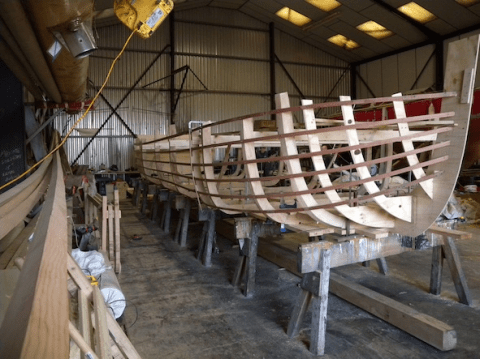 Wye trow being built at boat builders T Neilsen of Gloucester Docks for the Royal Jubilee