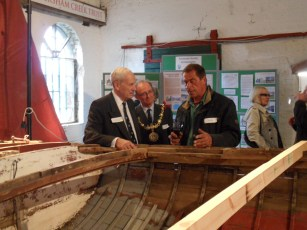 Admiral Boyce talks with boat building instructor Simon Grillet