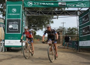 Mixed race leaders Ariane Kleinhans (left) and Lourens Luus took their second stage win for Team RECM on day two of the three-day Nedbank sani2c mountain bike stage race on Friday. Photo: Full Stop Communications
