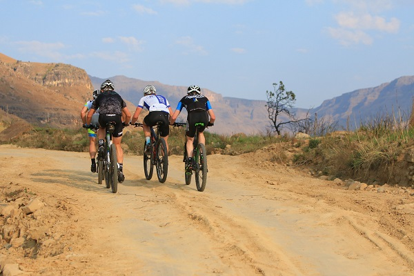 Teams working together up the iconic Sani Pass on day two of the Dragon are not an uncommon sight as riders tackle the 17km journey to the top. Photo: Greg Labuschagne Photography