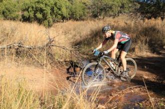 A rider going through a puddle at the Waterberg MTB Encounter