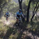 A team passes through a wooded area at the Waterberg MTB Encounter