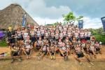 uBhejane Xtreme MTB Challenge riders gathered for team photo at the rhino statue inside the Hluhluwe Game Reserve. Photo: Supplied..