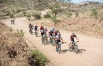 Riders bunched up and pushing together through the desert plains. Photo: Gondwana Collection Namibia