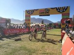 Investec-Songo-Specialized's Jaroslav Kulhavy and Howard Grotts pictured crossing the finish line in stage five of the Cape Epic in Wellington today. Photo: Cape Epic/Zoon Cronje