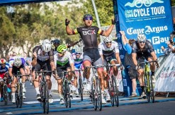 Team BCX's Nolan Hoffman lifts his arms in celebration after crossing the finish line first at the Cape Town Cycle Tour. Photo: Toby Ginsberg