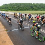 A bunch of riders pass the elite riders during this year's Tour Durban