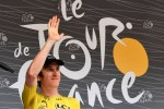 Overall leader Geraint Thomas, of Team Sky, waves to fans after stage 13 of the Tour de France.