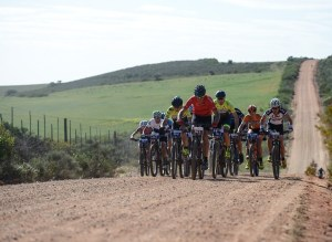 A bunch of riders moving on a gravel road during stage one of the Cape Pioneer Trek. Photo: Marike Cronje