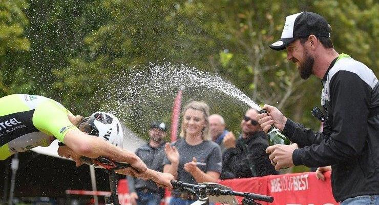 Matthys Beukes enjoying a champaigne celebration after winning the Attakwas Extreme. Photo: ZC Marketing Consulting