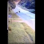 CCTV footage of a cyclist ambushed, robbed and pushed off his bicycle