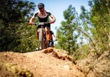 A rider about to drop down a descent during the TransCape MTB Encounter. Photo: Jacques Marais