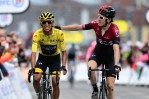 This year's Tour de France champion Egan Bernal rides alongside defending champion and teammate Geraint Thomas