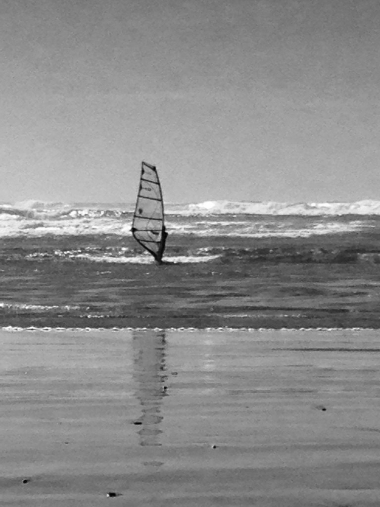 Mid-coast Oregon,Solitude: windsurfer enjoying the waves