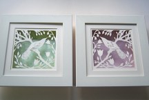 Bird in Spring papercuts in box frames.