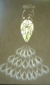 Peacock papercut backlit