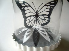 Butterfly and flower bell jar back view