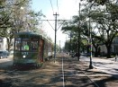 A streetcar heads down St. Charles Avenue. The neutral ground - the local term for the street median -- is a popular place for runners because of its long unbroken stretch and the soft but sure footing it provides.
