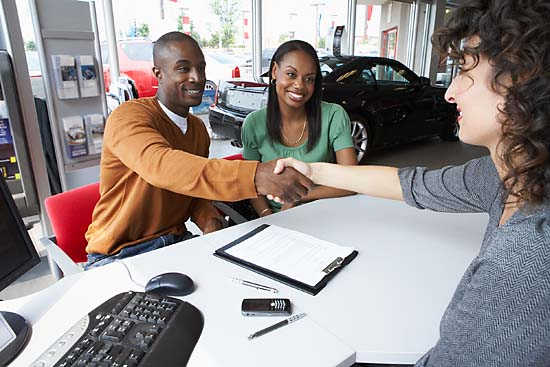Shaking hands car dealer