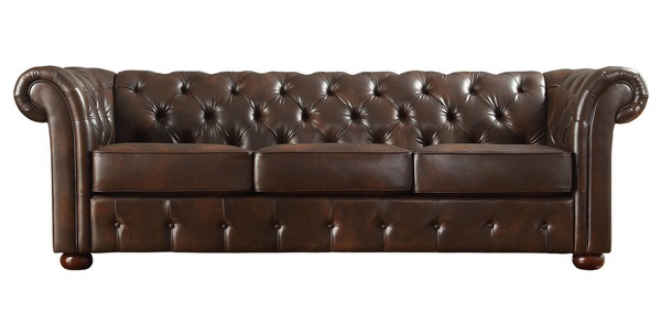tufted brown leather sofa pillow event rental