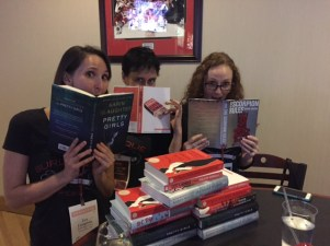 Eva, Dawn, and Jeni, displaying some of the many free books we received.