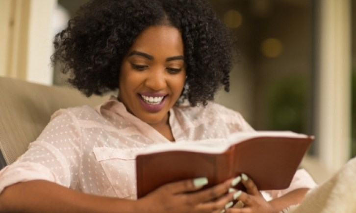 Women Reading Her bible