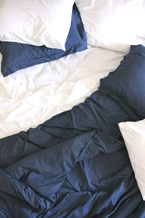 Cozy navy duvet and white sheets