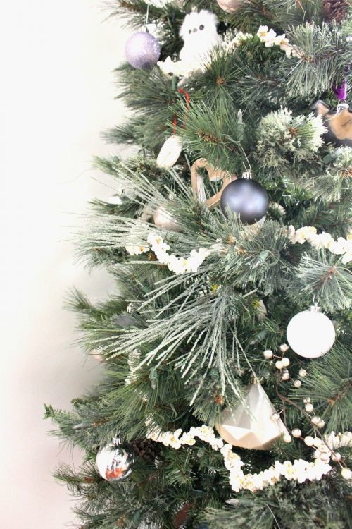 add sprigs with varying textures to make christmas tree look fuller