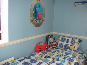 boys room, car and thomas cushions, blue walls, numbers bedding, finding nemo wall art