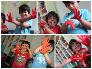 messy play painted hands