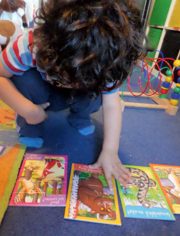 2 year old doing gruffalo puzzles