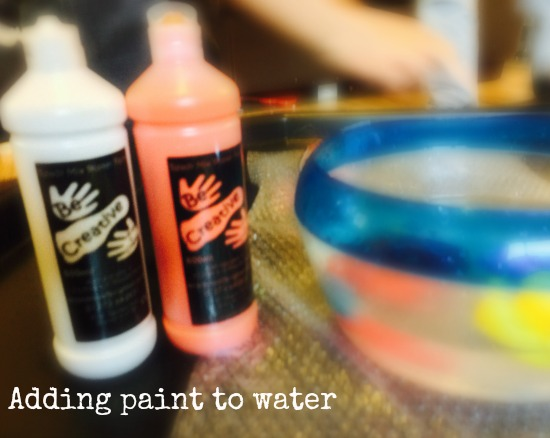 water play mixing colours with paint and water