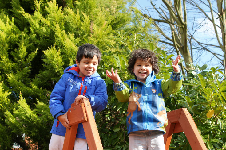 springtime fun kids high on the climbing frame