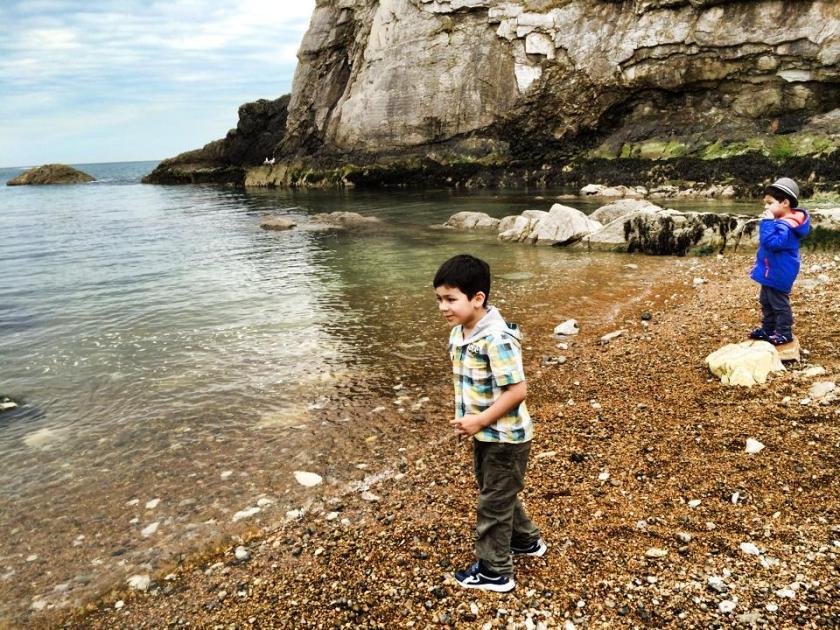 skimming rocks into the sea