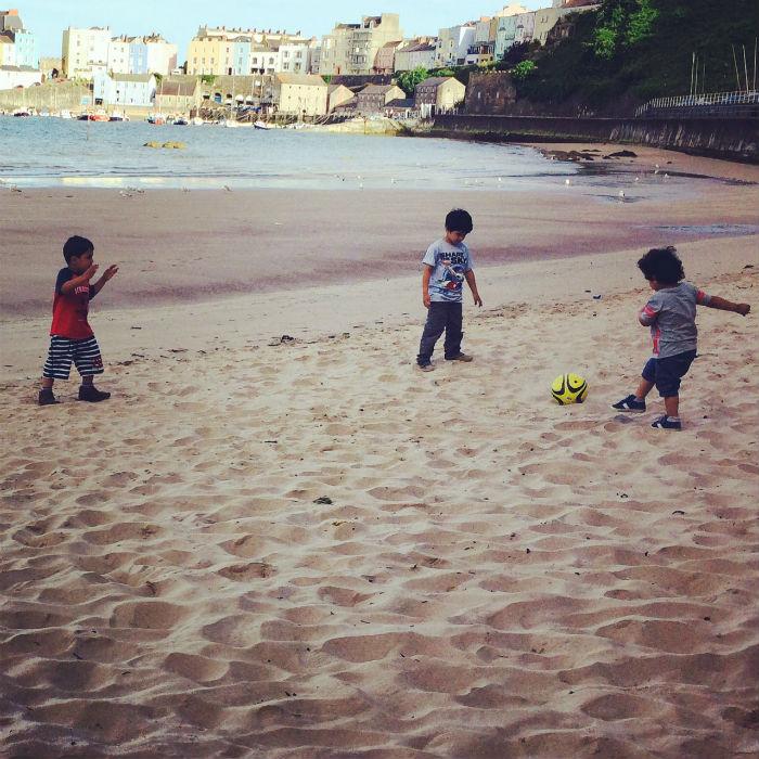 playing football on tenby beach