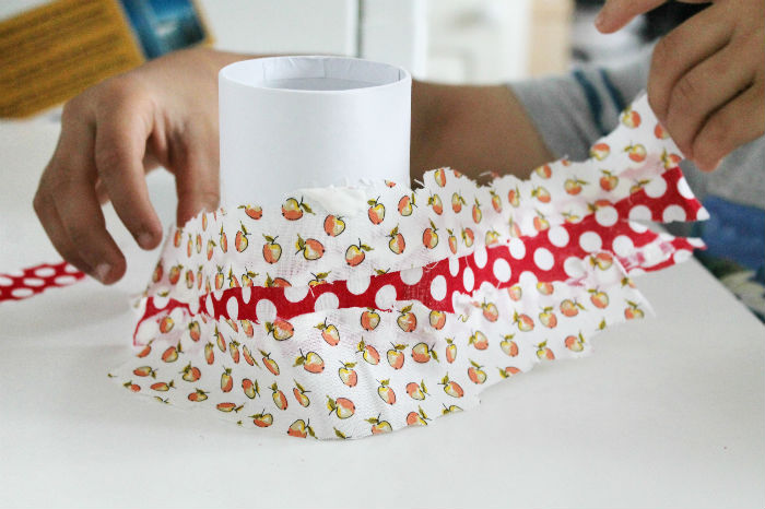 applying fabric to our diy crayon pot