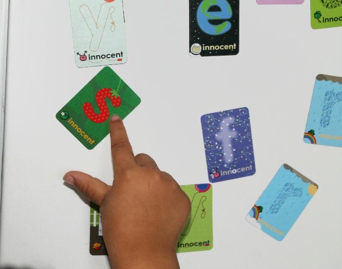 letter recognition with letter magnets from innocent drinks packs